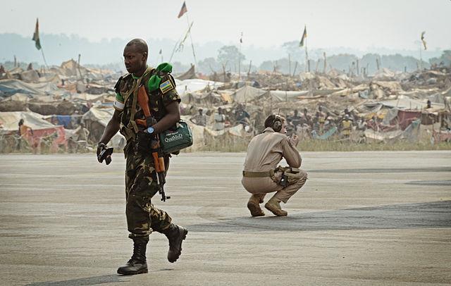 A Rwandan soldier, left, exits a U.S. Air Force C-17 Globemaster III aircraft near a refugee camp full of displaced residents at Bangui M'Poko International Airport. Photo by SSgt Ryan Crane (public domain)